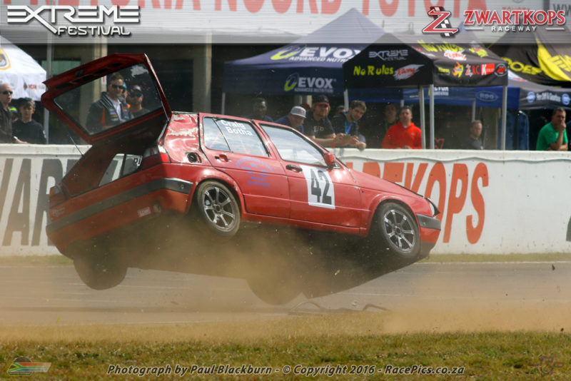 That's How We Roll: Craig Botha's DCM Motors Golf completes a flip in front of the Zwartkops pits after being nudged by another car. The driver was unhurt.
